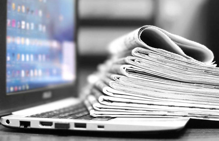 close-up of newspapers on laptop