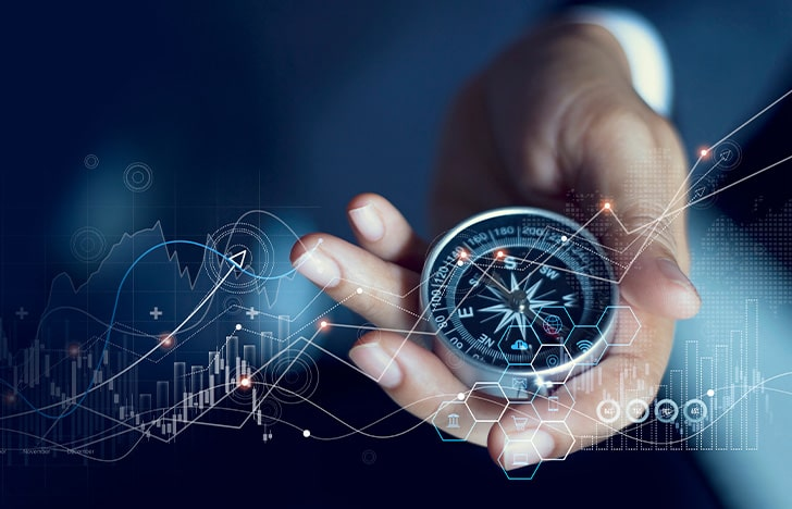 business man holding compass with pathways overlaid