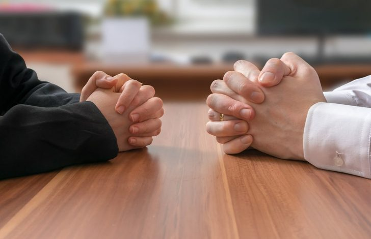 close up of buyer and seller negotiating a deal